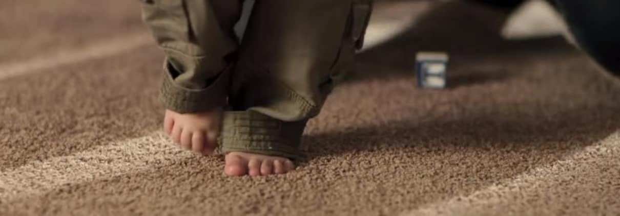baby walking on carpet