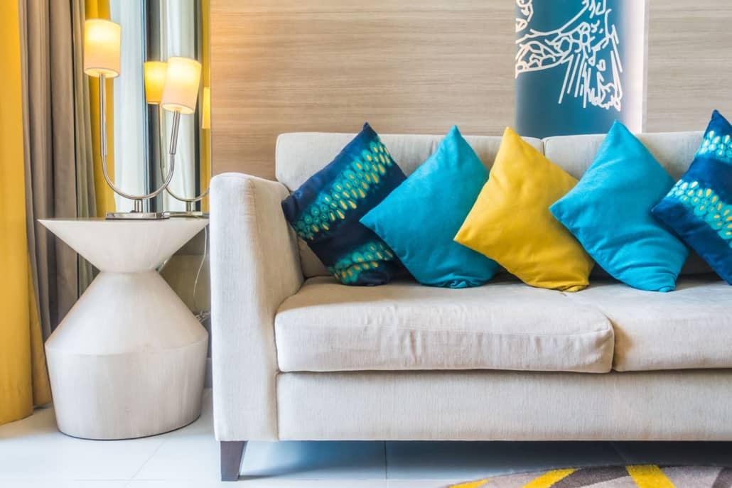 white sofa with blue cushions