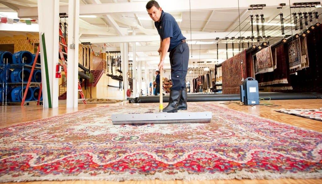 Guy cleaning oriental rug